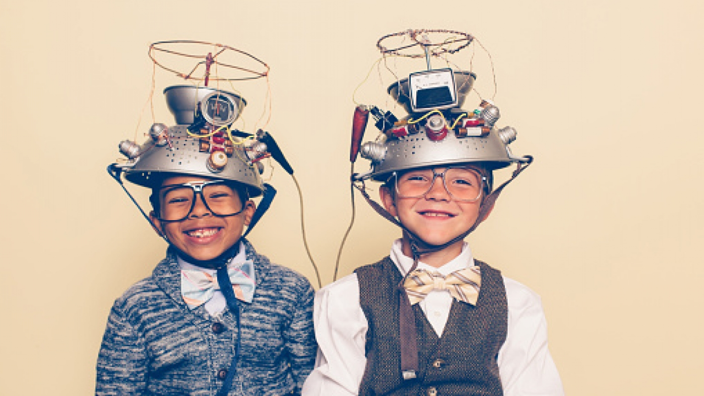 Two Boys Dressed as Nerds Smiling with Mind Reading Helmets