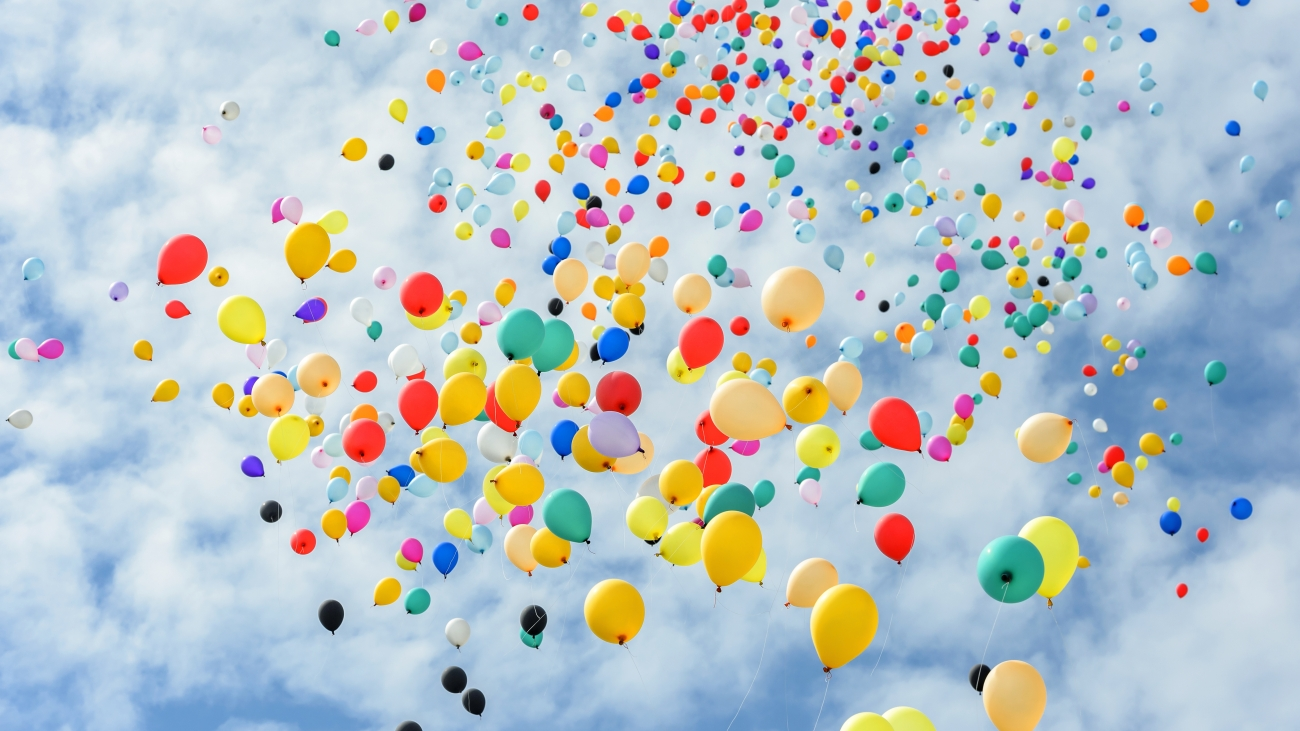 Multicolored balloons flying to the sky.